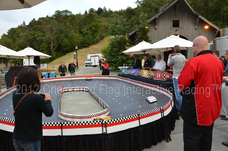 Checkered Flag Interactive Racing entertaining at a corporate incentive event with their remote control NASCAR-style racing